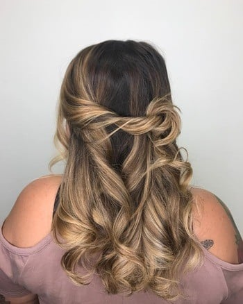 Dark brunette base and blonde highlights create bronde haircolor.