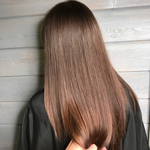 Shades EQ gloss used to enhance natural brunette haircolor.