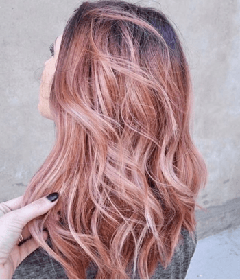 : Deepen your pink hair by adding shadowed roots at the hairline.