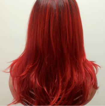 Fire engine red hair color created by Redken Artist, Linda Macchi.