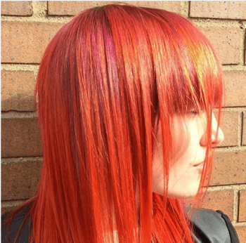 Sunset orange hair color created by Redken Artist, Chiala Marvici.