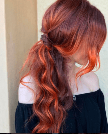 A sheer wash of makeup is the perfect match for bold red hair.