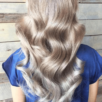 Model with silver hair and big curls