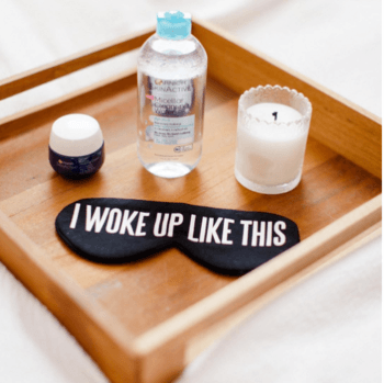 Breakfast tray with eye mask and skincare products