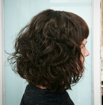 Let curly hair shine through with a face-framing bob.