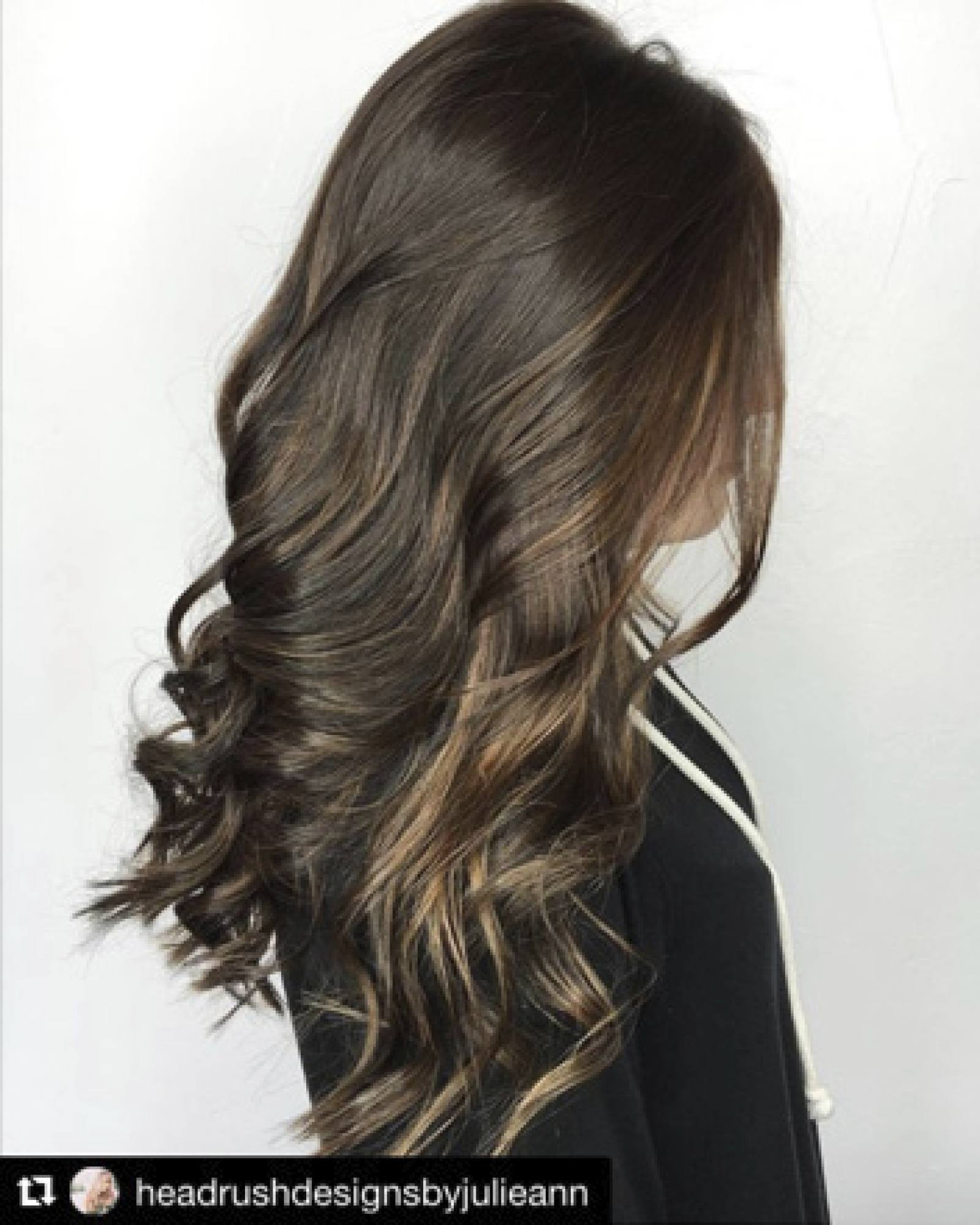 Brunette model with gold highlights and curly hair style