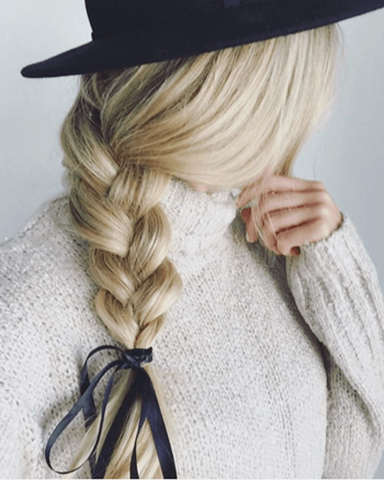 Side ponytails are an easy winter hairstyle that pair perfectly with hats, scarves, and turtlenecks.