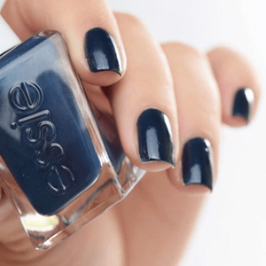 Model showing off navy blue manicure.